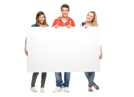 handsome teenage guy: Friends holding blank poster