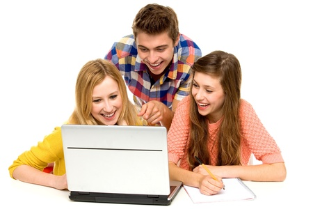 student desk: Young people looking at laptop