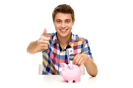 Man with piggy bank showing thumbs up photo