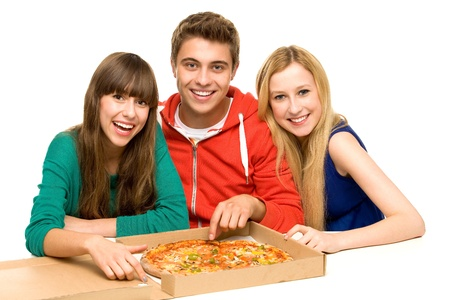 Drie vrienden eten van Pizza Stockfoto