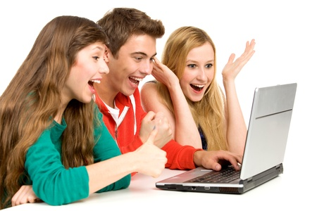 using laptop: Young people looking at laptop