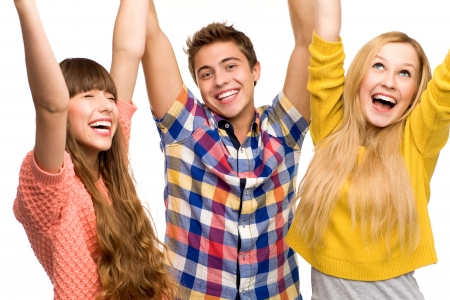 teenagers laughing: Friends with arms raised