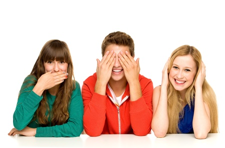 covering eyes: Young people covering their mouths eyes and ears Stock Photo