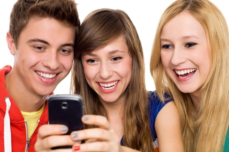 Friends looking at mobile phone Stock Photo - 10824908