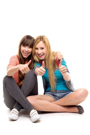 Two girls with thumbs up Stock Photo - 10824885