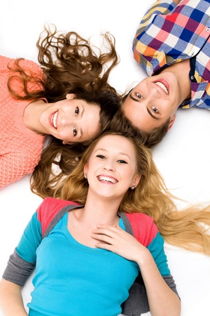 Three young friends lying down photo