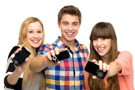 Friends holding mobile phones Stock Photo - 10824890