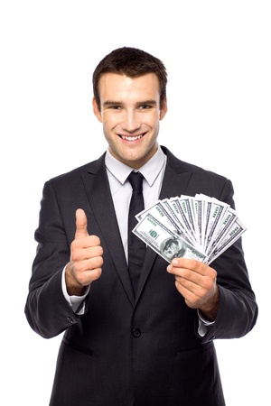man holding money: Businessman holding dollar bills