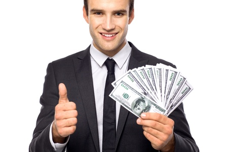 man holding money: Businessman holding dollar bills