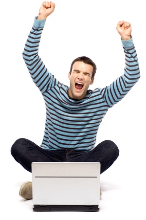 Excited man with laptop Stock Photo - 10944353