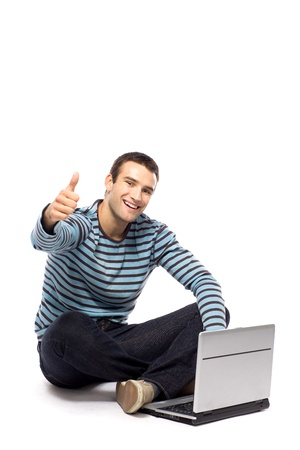 Man with laptop showing thumbs up Stock Photo - 10944348