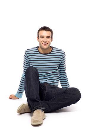 Casual guy sitting Stock Photo - 10944349