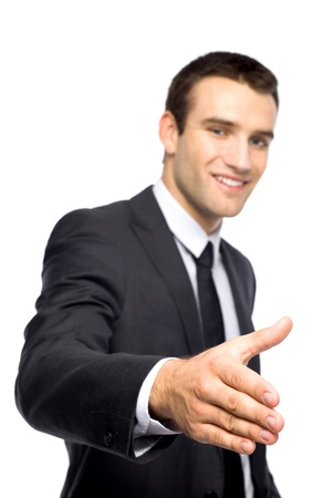 business handshake: Businessman extending his hand for a handshake Stock Photo