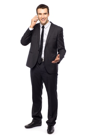 businessman phone: Young businessman standing