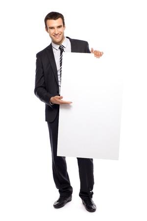 Businessman holding blank poster Stock Photo - 10982274