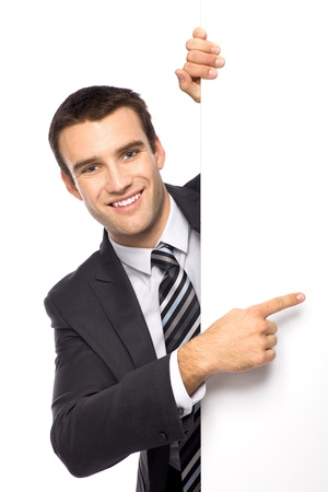 presenting: Businessman holding blank poster Stock Photo
