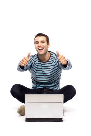 Man with laptop showing thumbs up photo