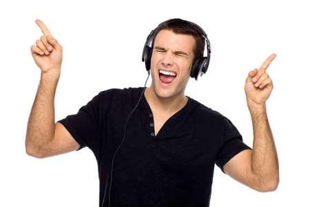 Young man enjoying music photo