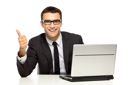 young executives: Businessman with laptop showing thumbs up Stock Photo