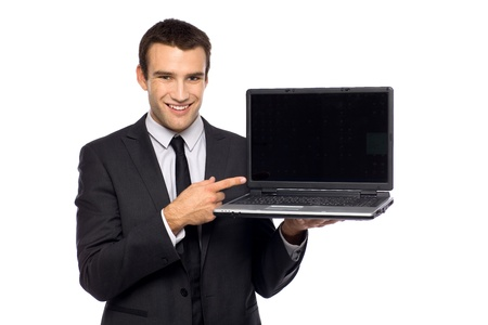 businessman with laptop: Businessman pointing at laptop