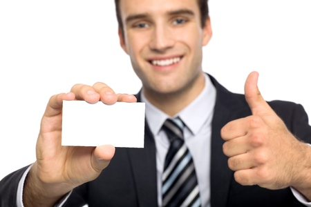 Man with business card showing thumbs up photo