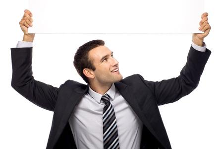 Businessman holding blank sign above his head Reklamní fotografie