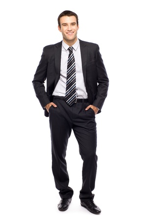 businessman standing: Businessman with hands in pockets