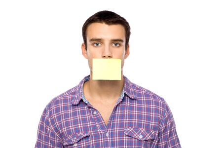 Man with post it on lips photo