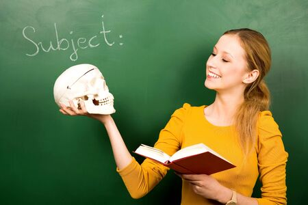 acting: Female student holding skull and book