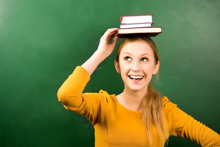 balancing: Woman balancing books on head