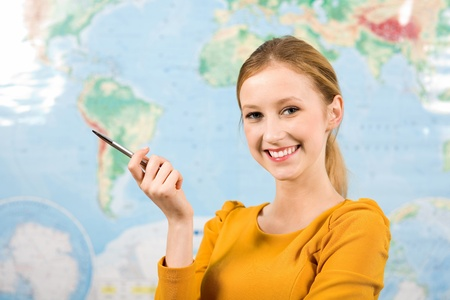 beautiful teacher: Female student in front of world map