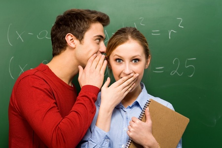 Students sharing secrets photo