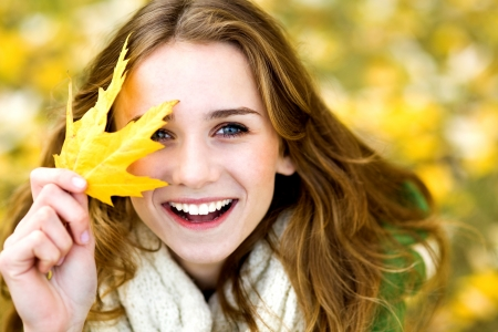 Woman holding autumn leaf photo