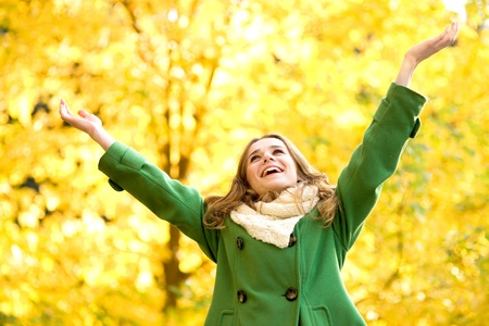 arms raised: Autumn woman standing with arms raised  Stock Photo