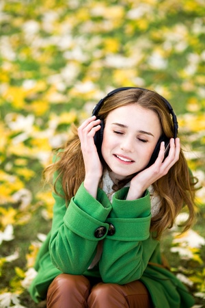 Girl enjoying music outdoors photo