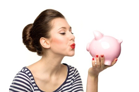 Pin-up girl kissing piggybank photo