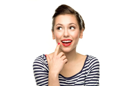 flirty: Young woman thinking Stock Photo