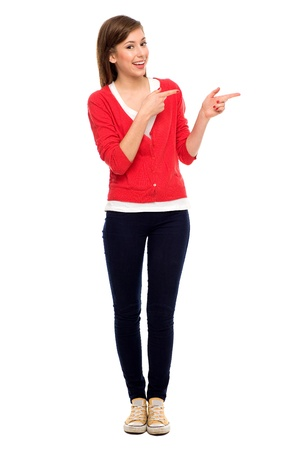 woman standing: Teenage girl pointing Stock Photo