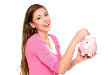 putting in: Woman putting coin in piggy bank