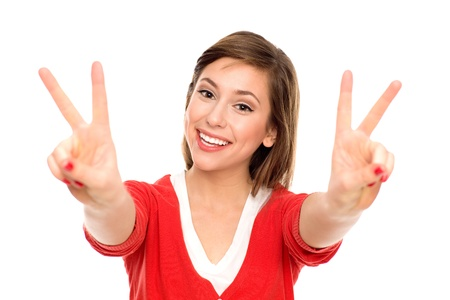 Young woman showing peace sign photo