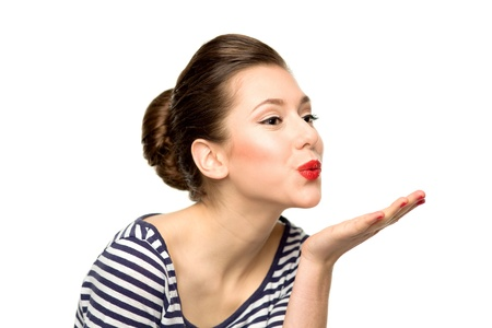 woman blowing: Young woman blowing a kiss Stock Photo