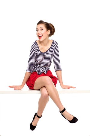 Pin-up girl sitting Stock Photo
