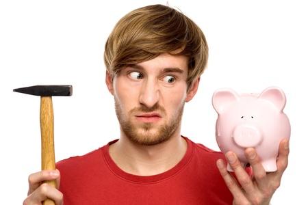 Man about to break a piggybank photo