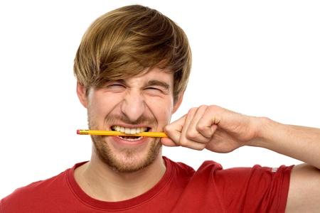 Young man biting a pencil photo