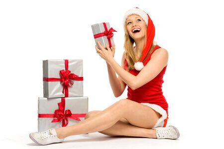 Woman in Santa hat holding gifts photo