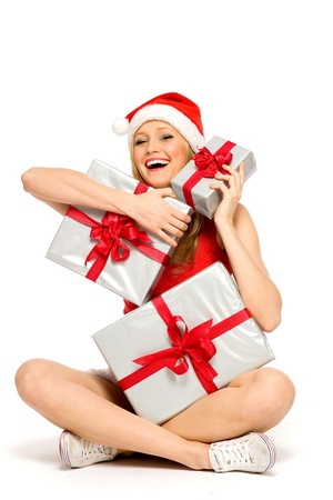Woman in Santa suit holding gifts photo