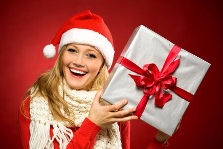 Woman in Santa hat holding gift photo