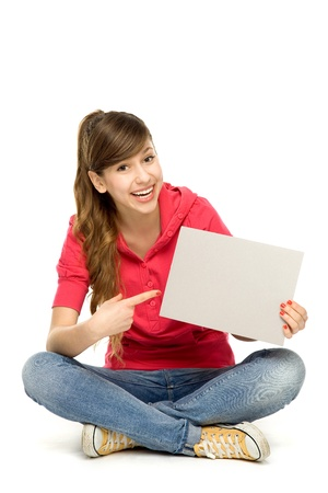 Young woman pointing at blank poster photo
