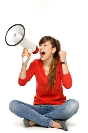 Teenage girl shouting through megaphone photo