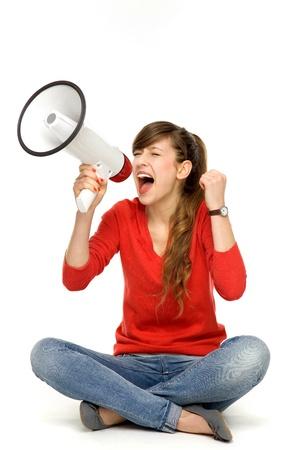 Teenage girl shouting through megaphone photo